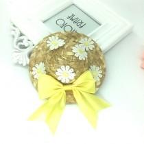 Zonnehoed met bloemetjes en gele strik
