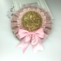 Zonnehoed met roze tule en strik